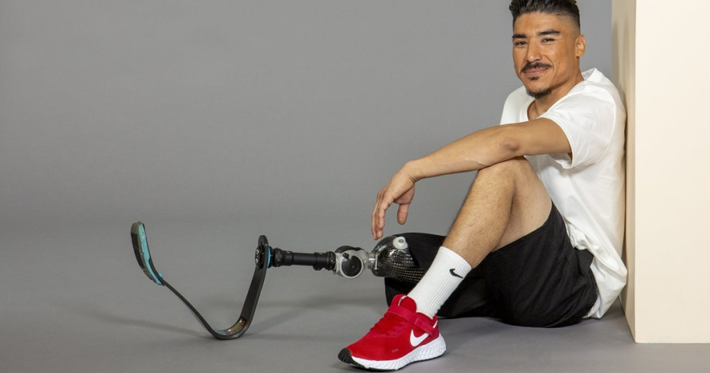man sitting down with a prosthetic leg