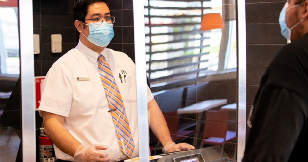 mcdonald's employee wearing face mask and gloves