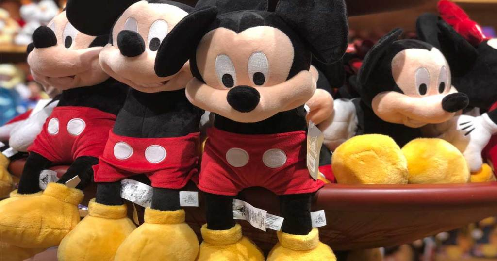 mickey mouse plush sitting on a cart