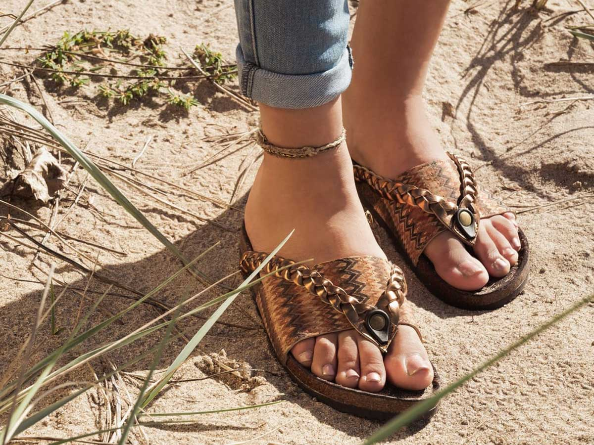woman wearing brown braided sandals outside