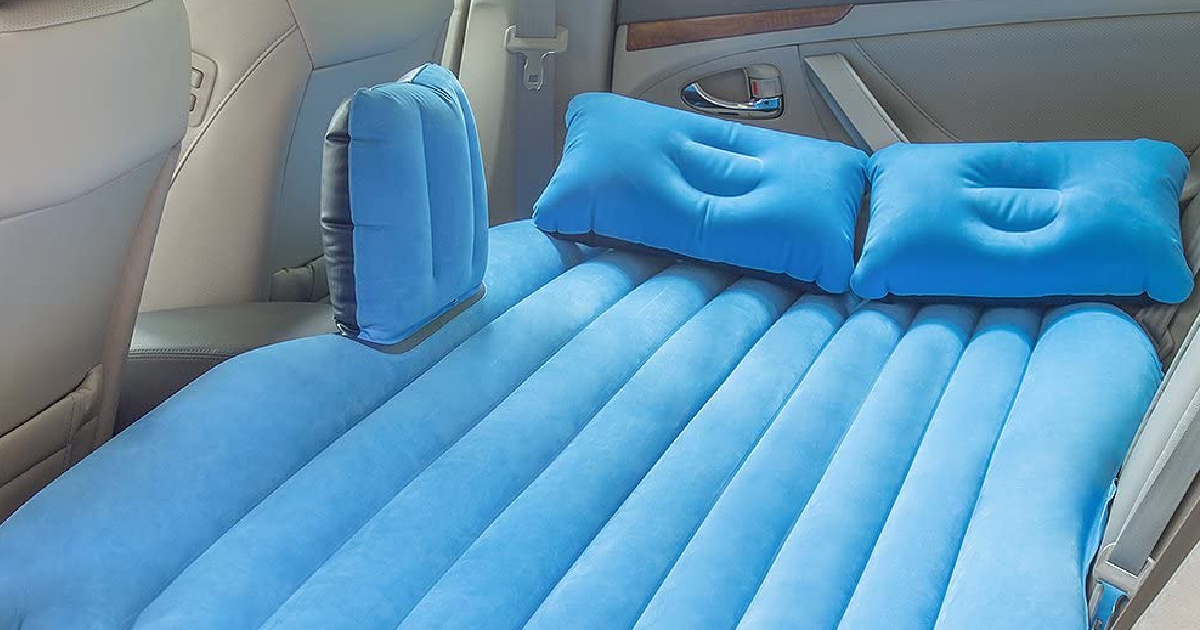 blue air mattress in back seat of car