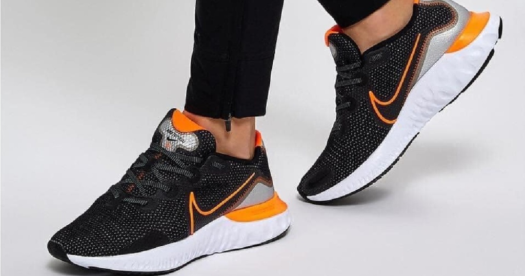 black and orange nike shoes with white soles
