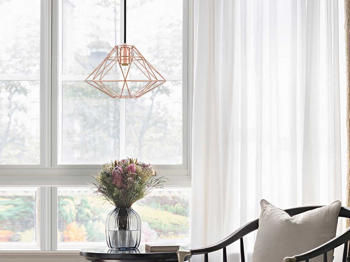 pendant light over a table with flowers