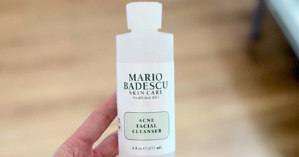person holding a Mario Badescu Acne Facial Cleanser, 6-oz