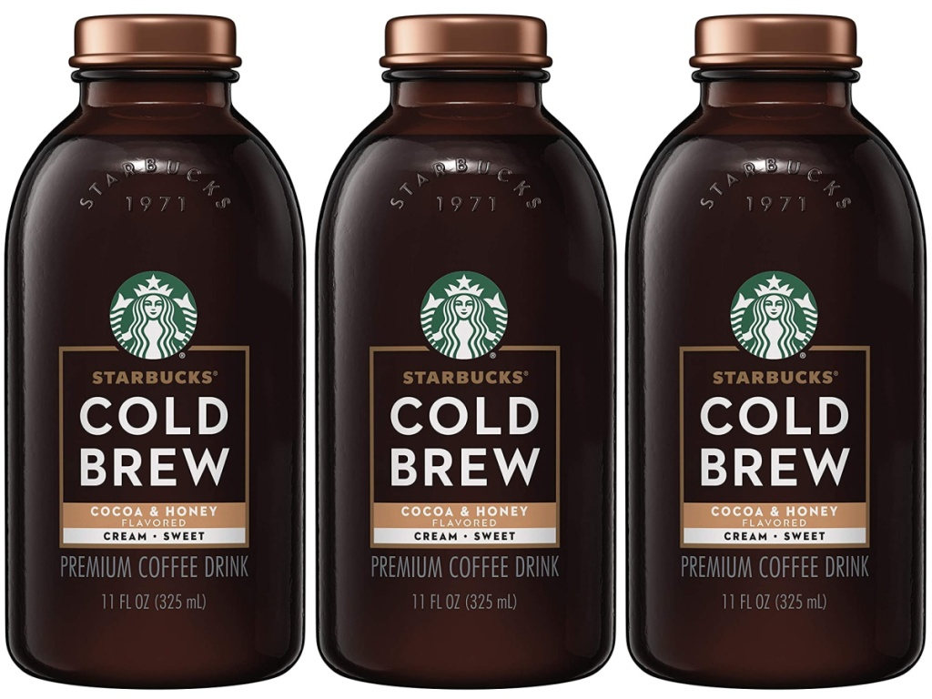 person holding a Starbucks Cold Brew Coffee, Cocoa & Honey with Cream bottles