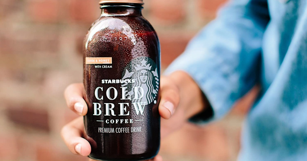 person holding a Starbucks Cold Brew Coffee, Cocoa & Honey with Cream