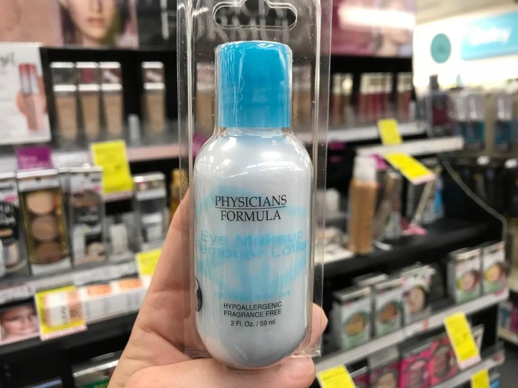 hand holding bottle of physicians formula makeup remover in cvs