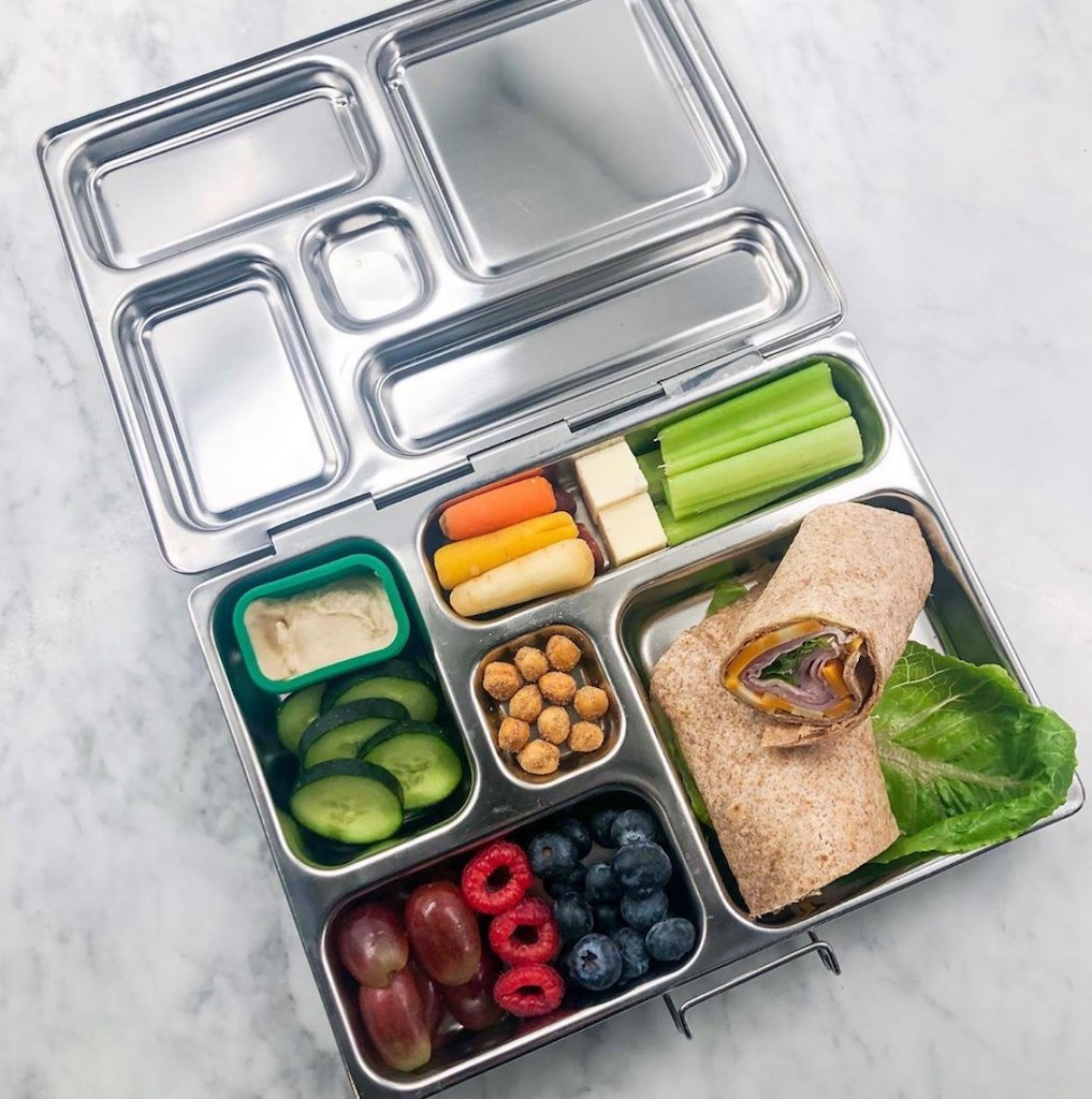 Planetbox lunch container filled with snacks, fruits, and veggies