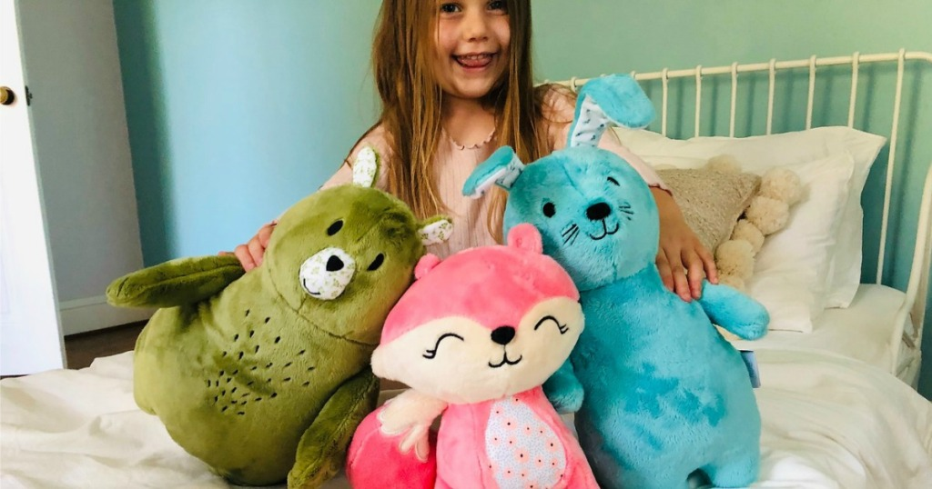 little girl with plush animals