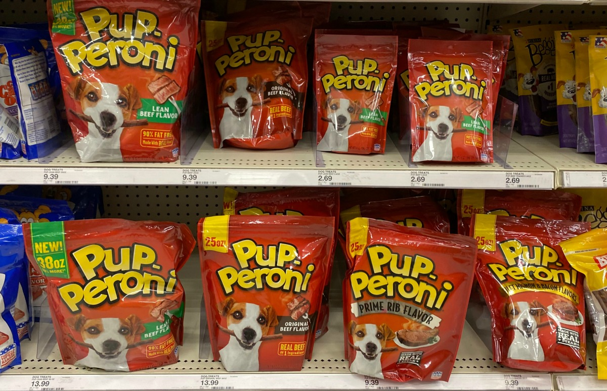 bags of dog treats on a store shelf