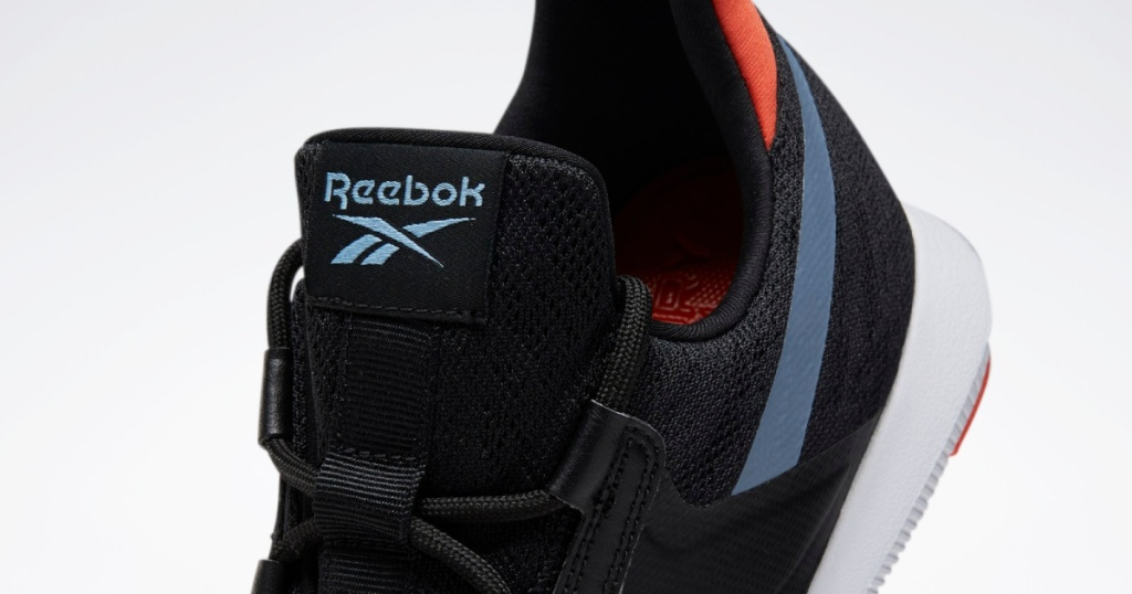 dark colored shoe with Reebok logo showing
