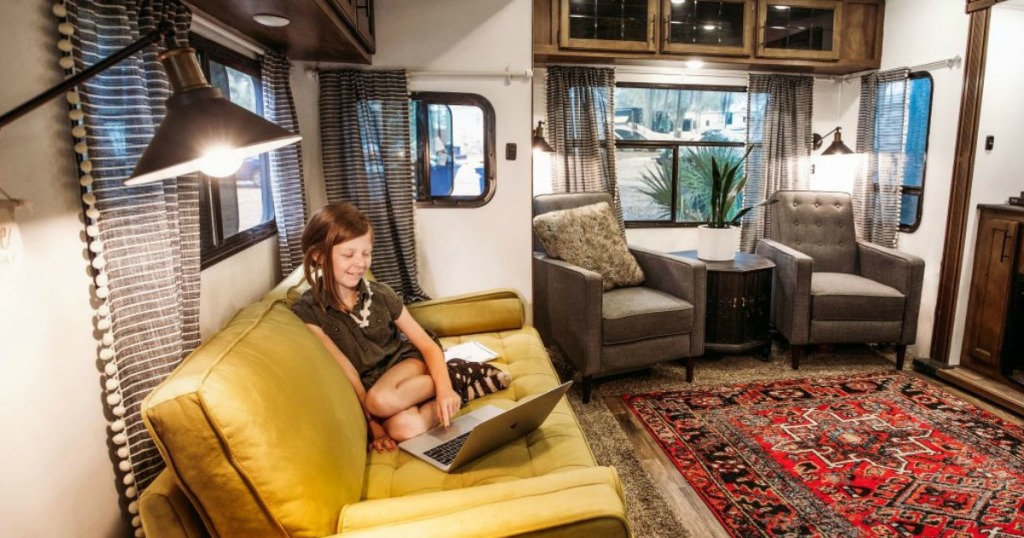 girl on laptop sitting in an rv