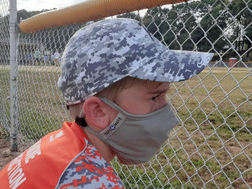 boy wearing gray face mask