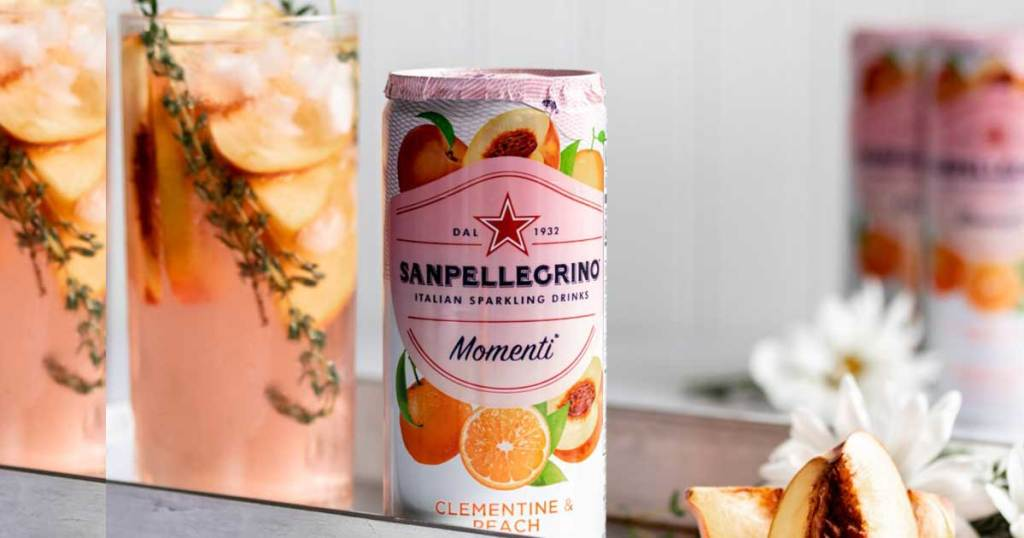 can of san pellegrino on a table