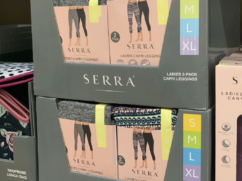 store shelf with packages of leggings on display