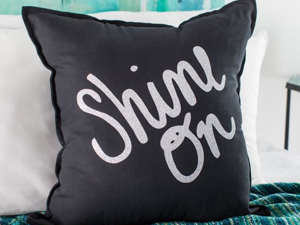 black pillow with glitter Shine On text