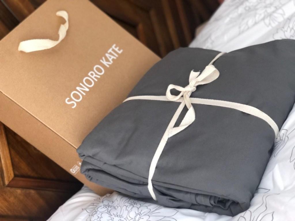 gray sheet set tied with ecru ribbon