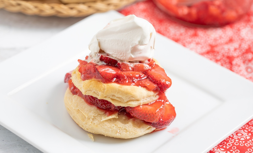 strawberry shortcake with whipped cream on top