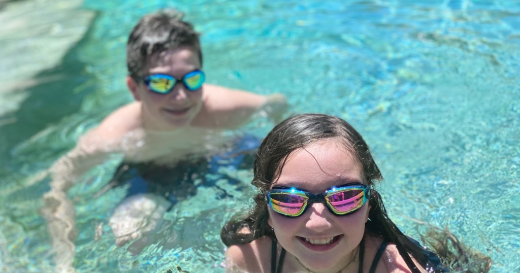 kids in pool wearing swim googles