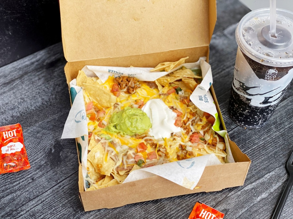 box with tacos in it and a drink sitting on the side