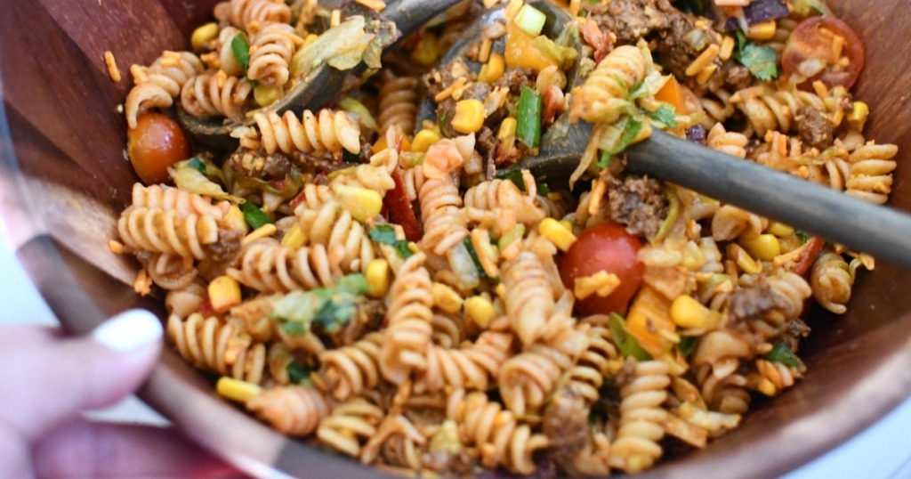 close up of taco pasta salad in wood bowl