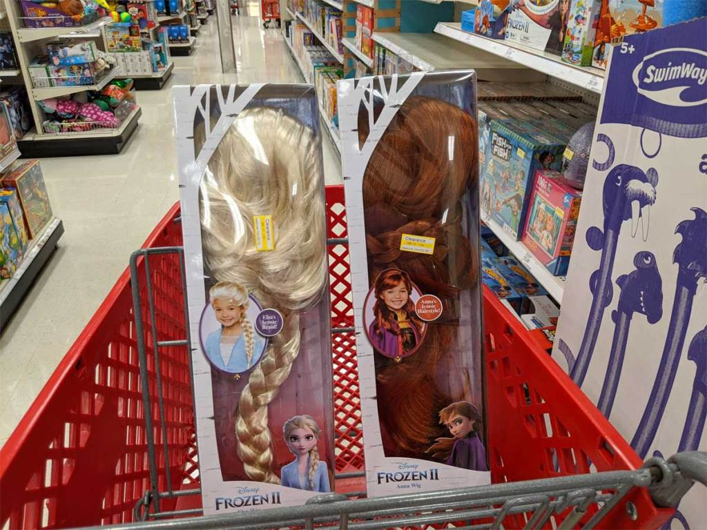 two doll wigs in a shopping cart