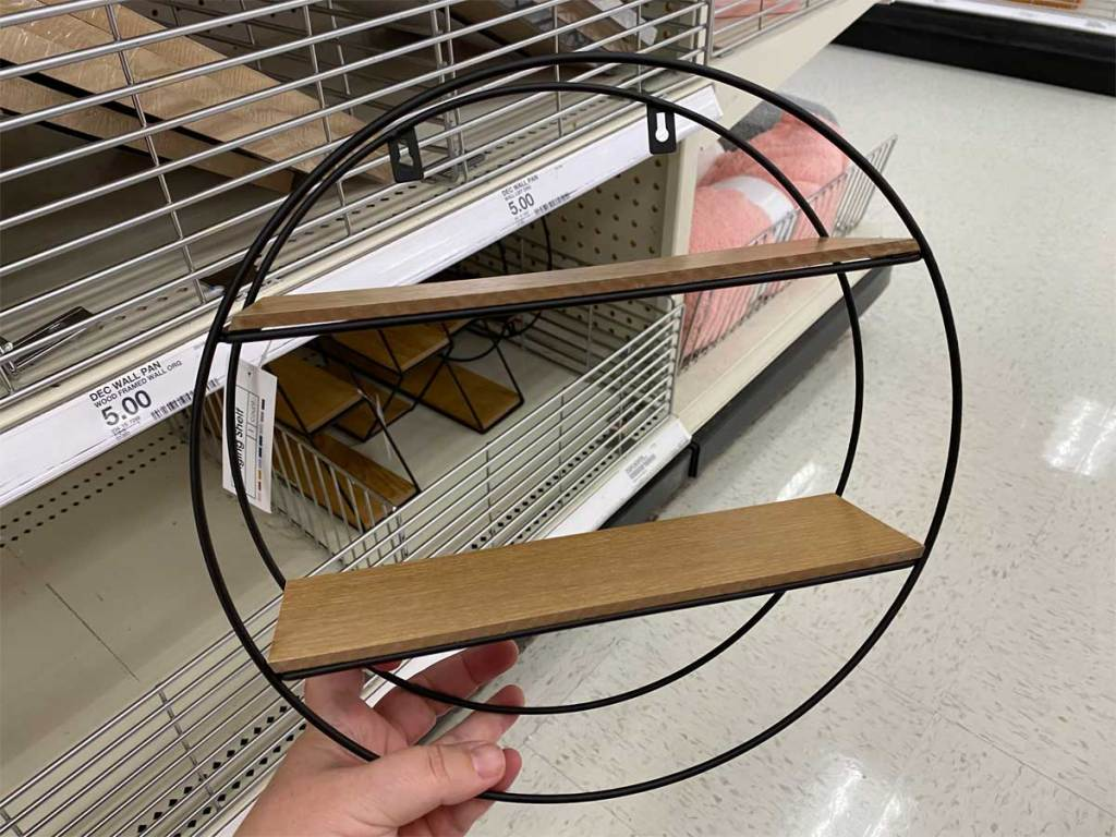 hand holding wood and wire shelf