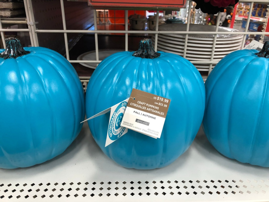 3 pumpkins in a teal color on store shelf