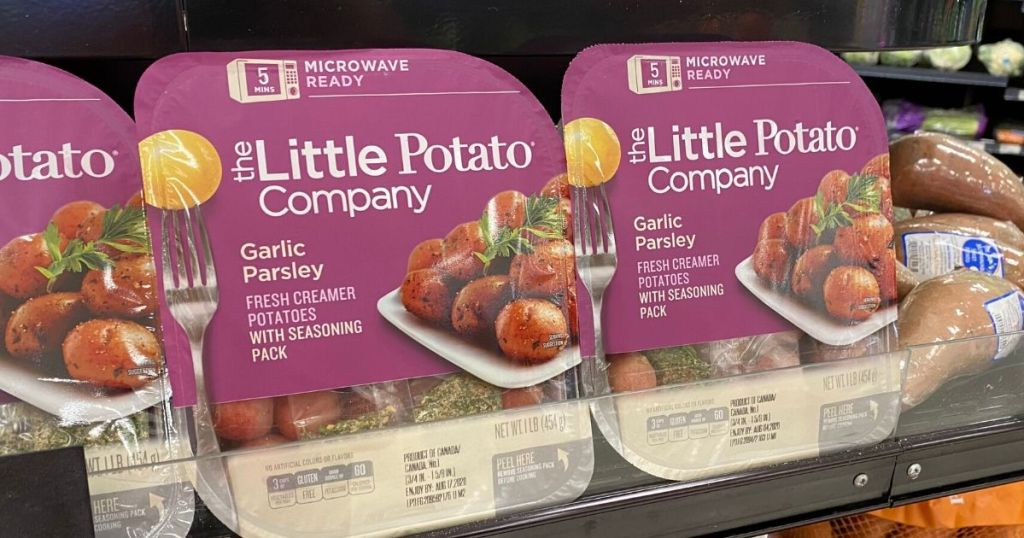 two trays of microwavable potatoes on shelf at store