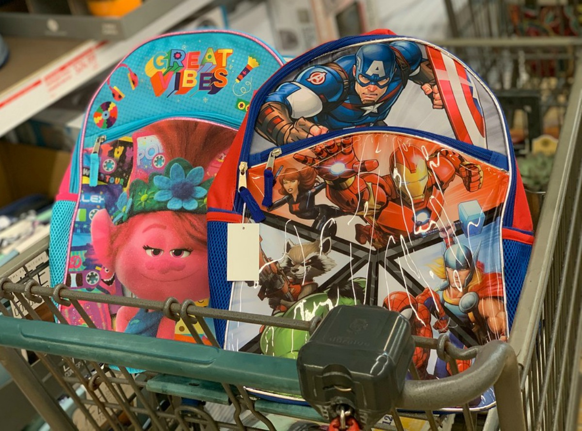 colorful character backpacks in a store cart