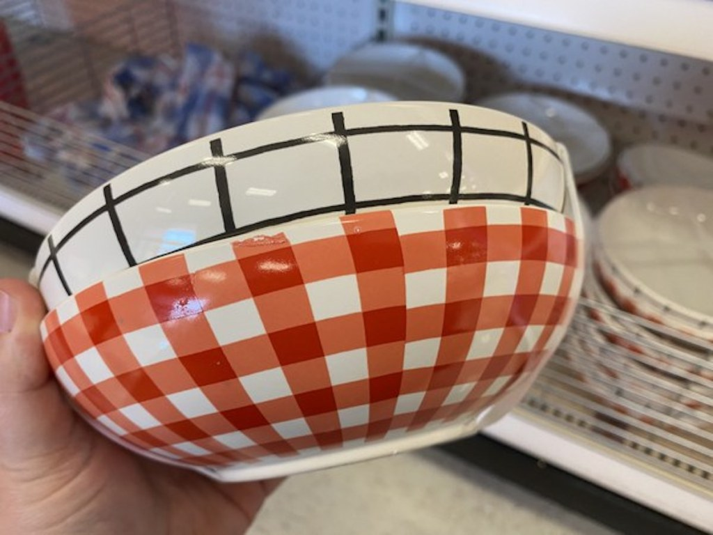red checkered and white with black squares bowls being held up from the Target Bullseye