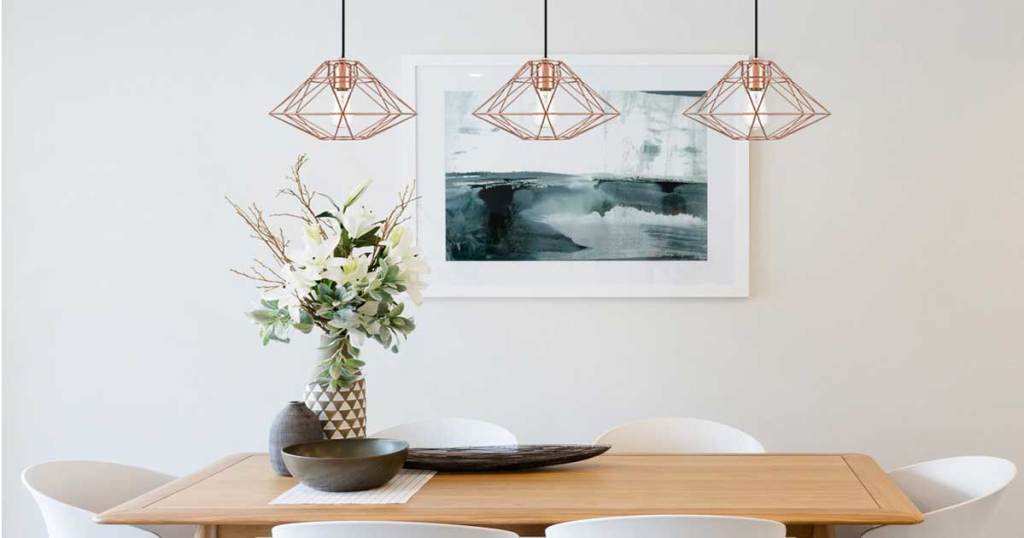 three pendant lights in a dining room