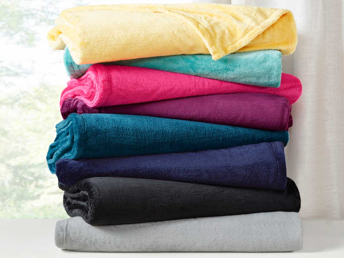 stack of plush blankets in a lot of colors
