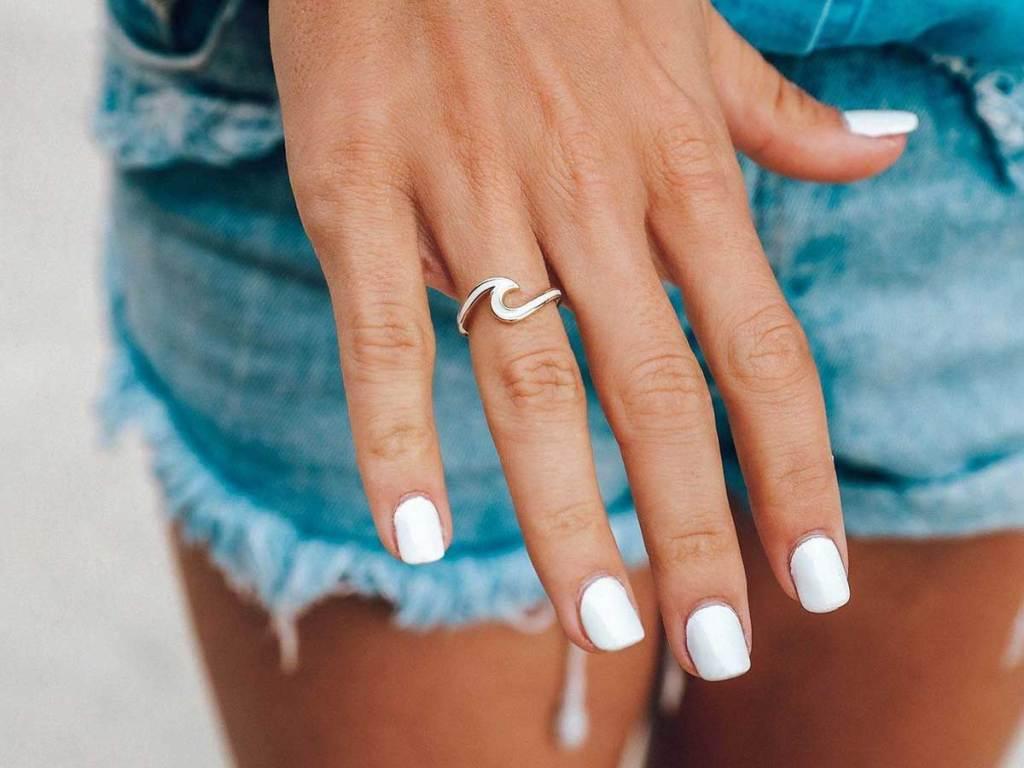 model wearing wave ring on finger