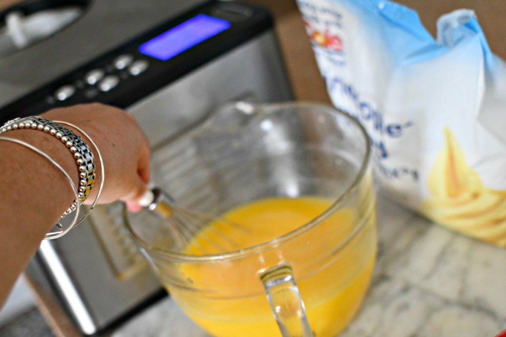 whisking together dole whip for ice cream maker