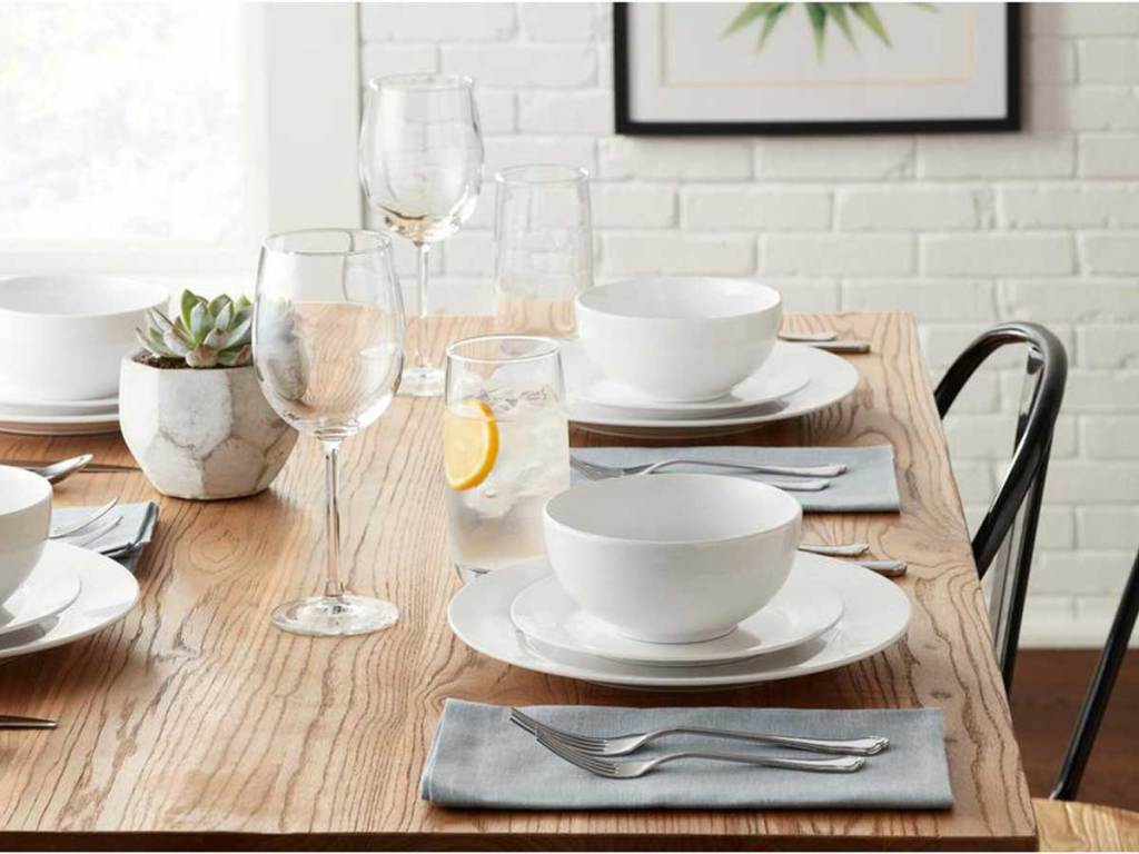 table set featuring white dinnerware and glasses