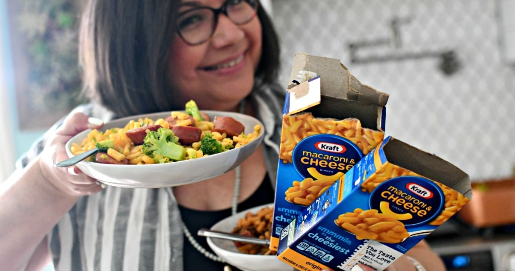 woman holding 3 different types of mac and cheese