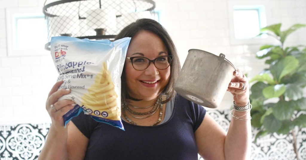 woman holding a bag of pineapple dole whip mix