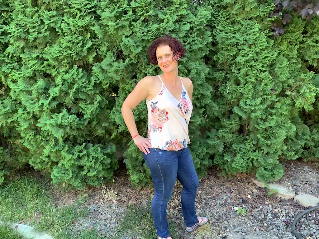 woman outside wearing jeans and tank top