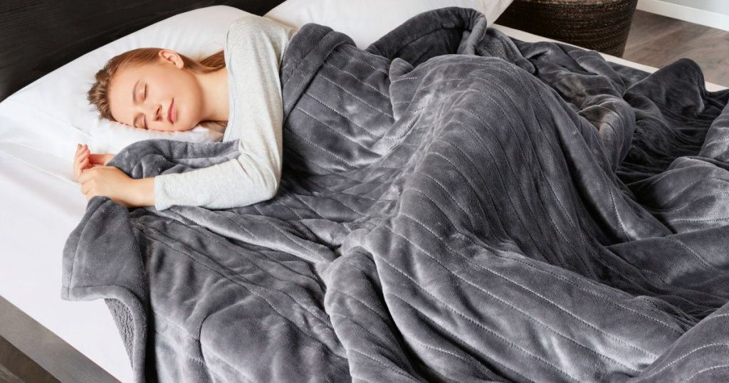 woman covered in bed with a Beautyrest Heated Microlight to Berber Solid Blanket