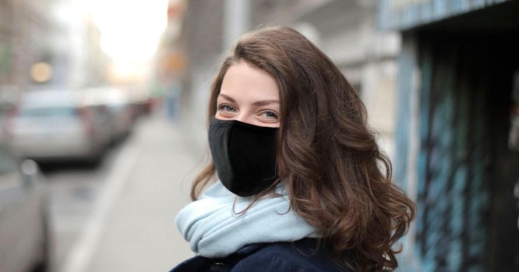 woman wearing a black face mask on street