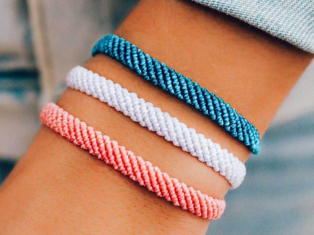 woven bracelets in three colors on wrist