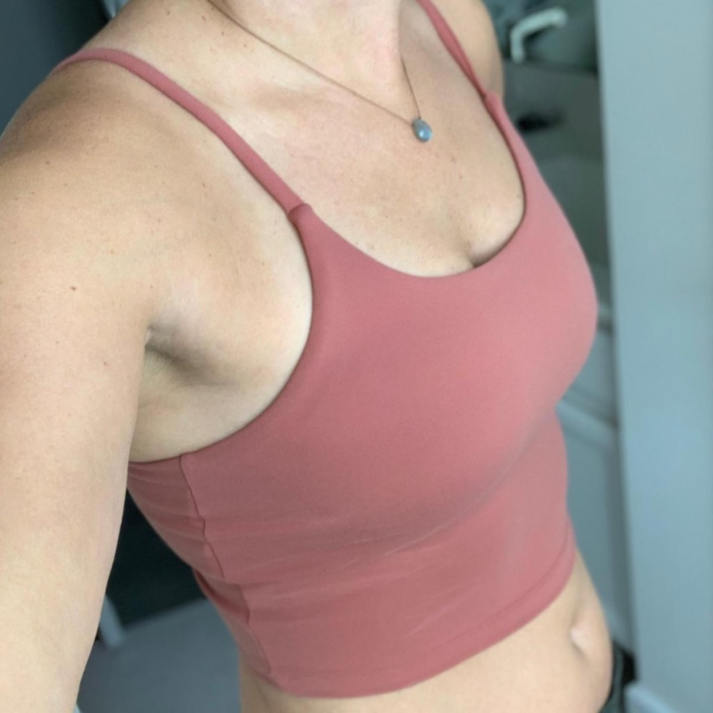 woman's midsection in mauve crop top