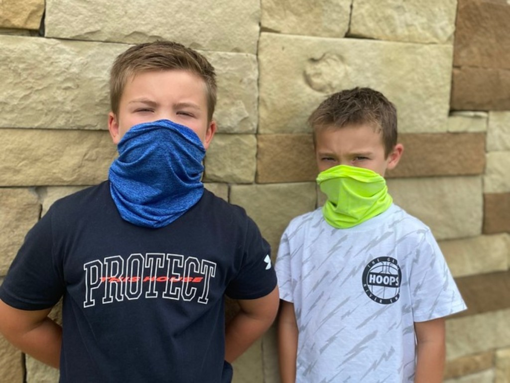 boys wearing gaiters over their faces