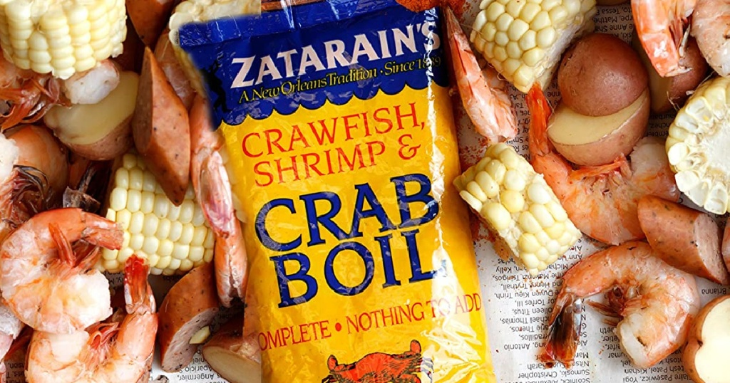 package of crab boil spices next to shrimp, potatotes and corn
