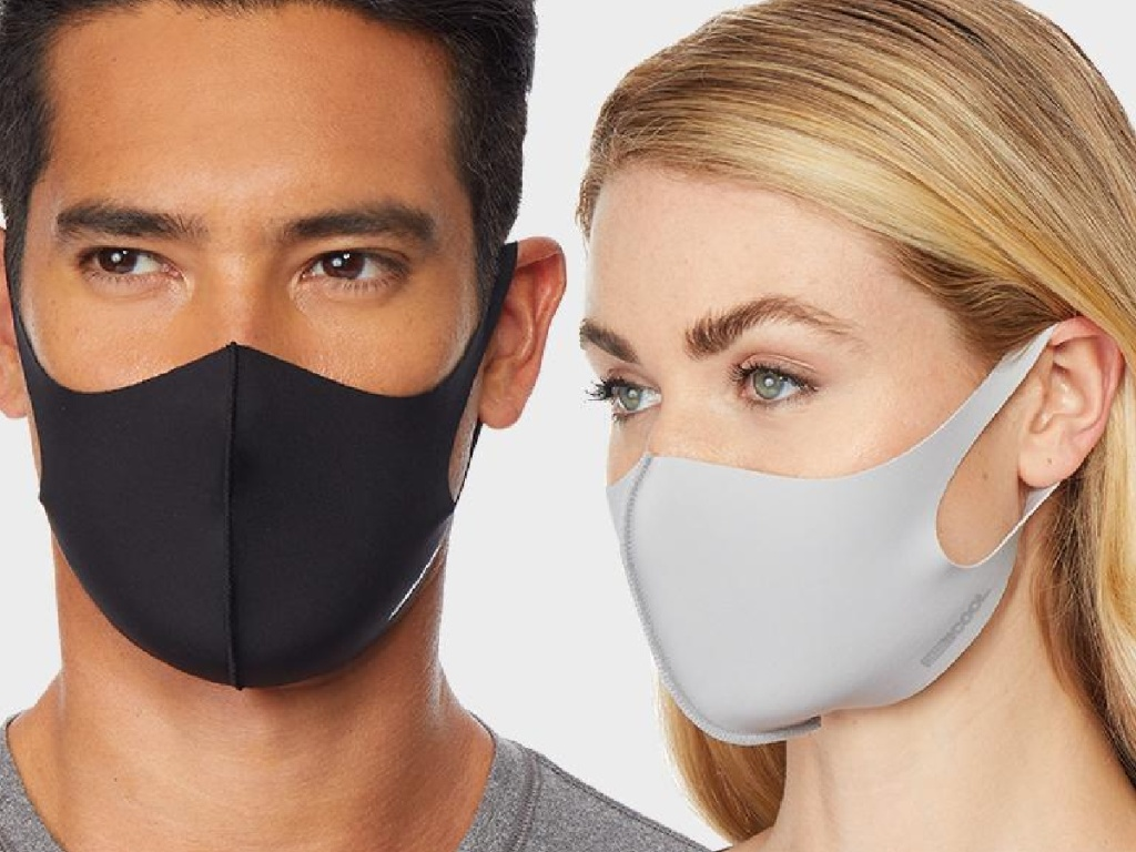 a man and a woman wearing reusable face masks