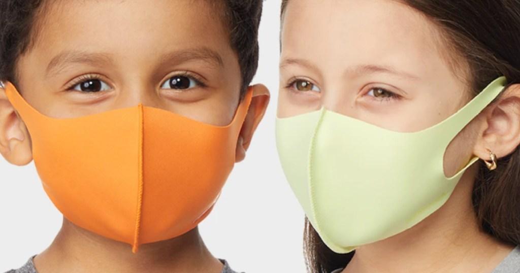 2 kids wearing reusable face masks