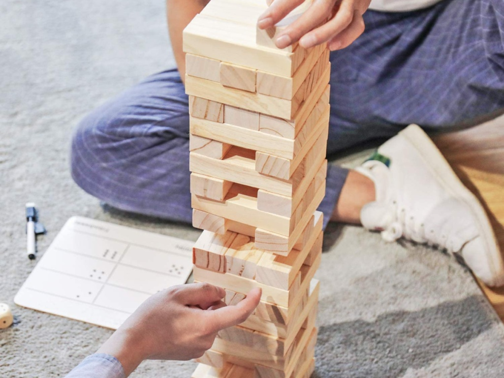 people playing tumble tower game