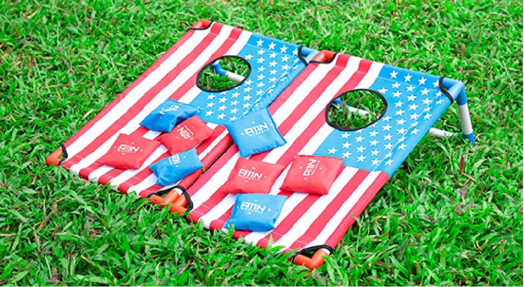 american flag bean bag toss game on grass