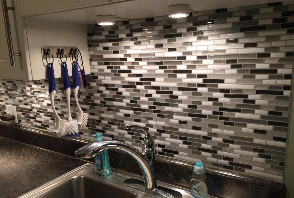 black white and gray backsplash on wall in kitchen